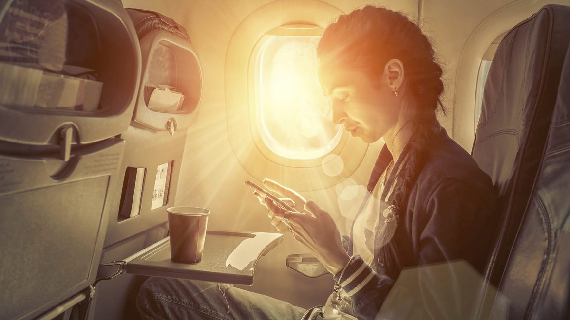 woman seat in the plane near the window